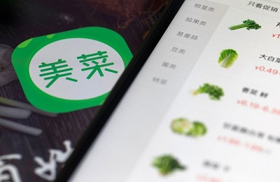 An icon for the Meicai application is displayed on a tablet in an arranged photograph taken in Hong Kong, China, on Thursday, Jan. 11, 2018. Meicai, a China startup that helps farmers sell vegetables to restaurants, has raised $450 million in a funding round led by Tiger Global Management and China Media Capital, according to people familiar with the matter. Photographer: Justin Chin/Bloomberg via Getty Images